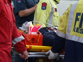 Paramedic and stretcher